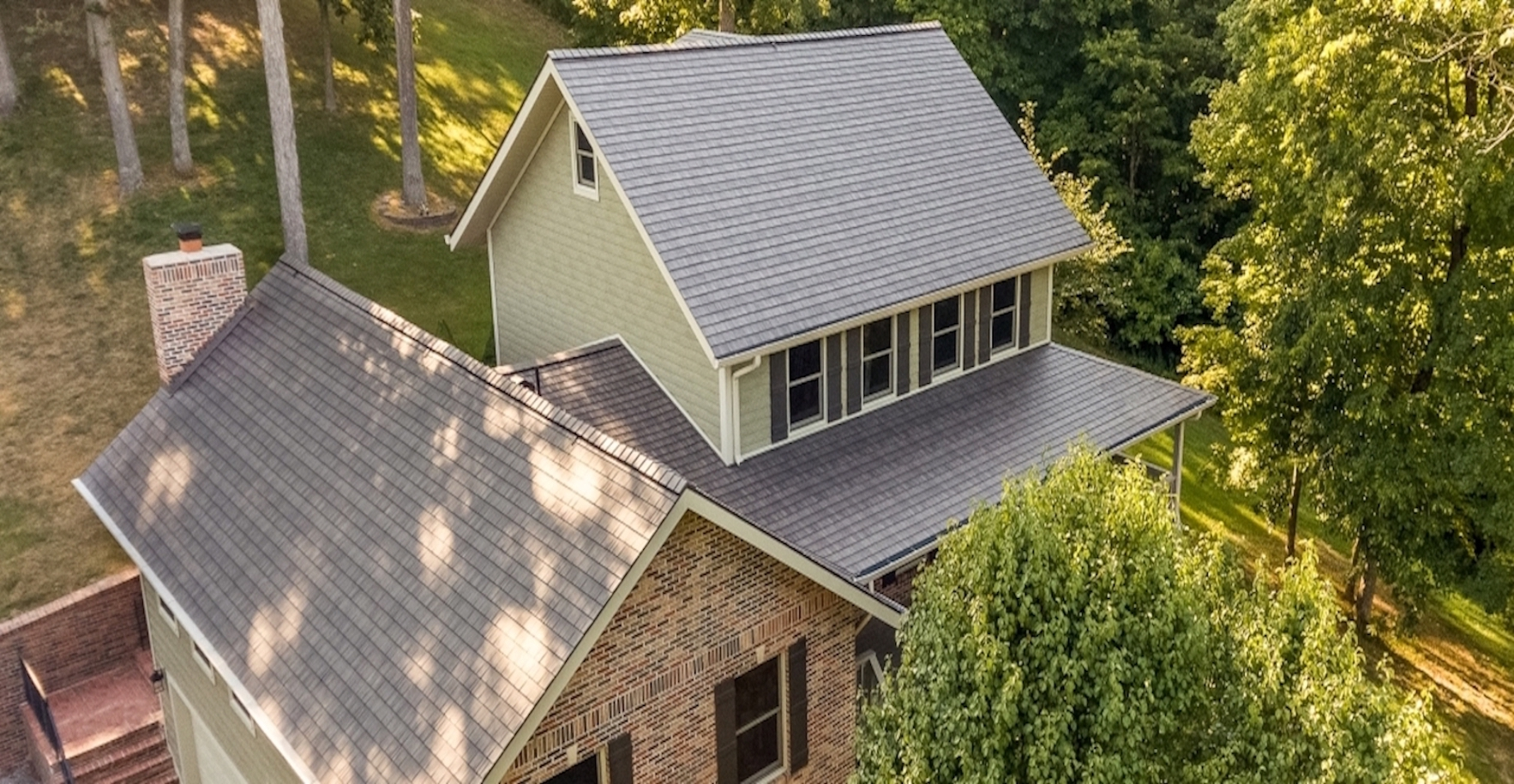 Top-View-Of-A-House-With-Blue-shingles-Roofing